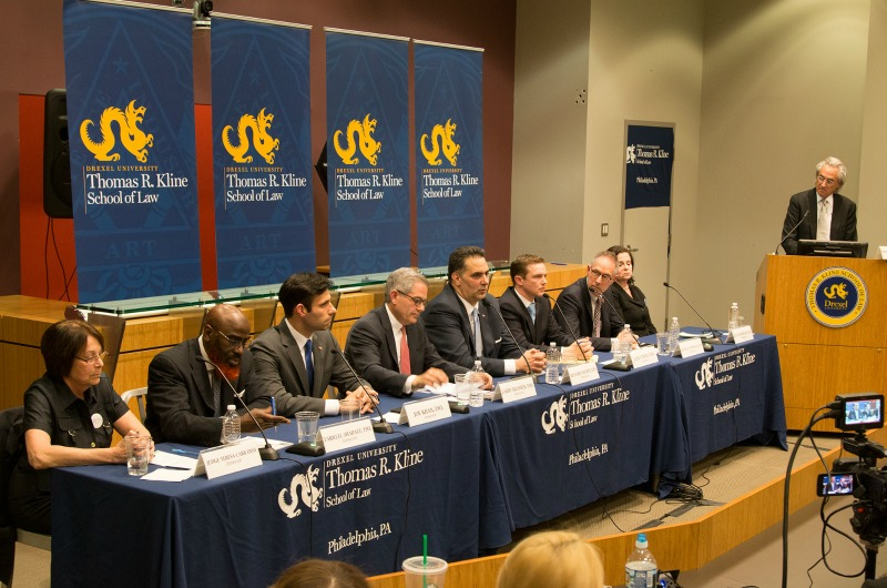 Thomas R. Kline moderates a debate among the eight candidates to be Philadelphia's next district attorney.